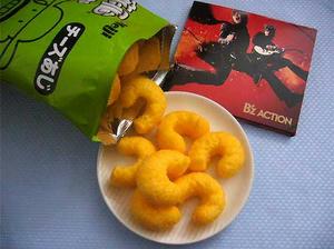 でかカールとB'zのCDアルバムACTION