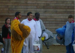 Theo Walcott in lion costume, Andrey Arshavin in shark costume