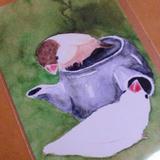 お急須で暖を取るシナモン文鳥と白文鳥のポストカード
