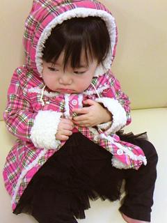 鼻水を吸われ凹み気味の赤子