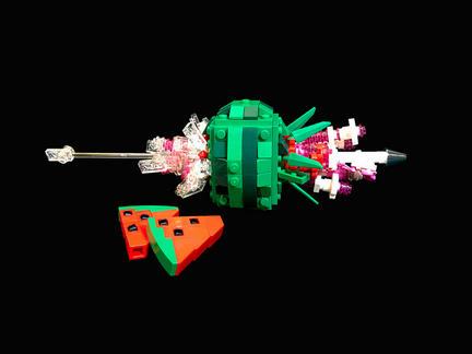 弾丸がスイカを貫いた瞬間のレゴ